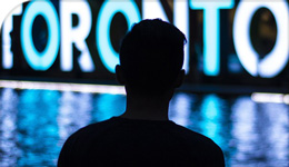 Toronto sign with silhouette of person in front | 2018-08-29